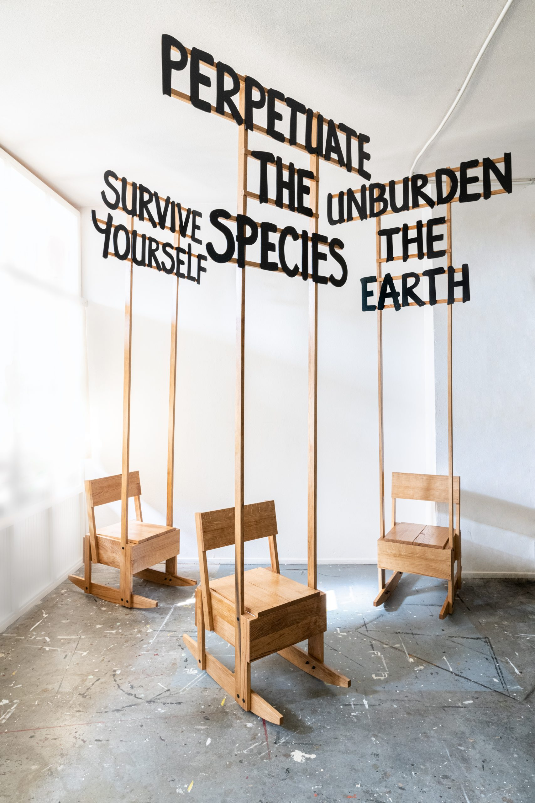 Birgit Verwer - Viriditas (SURVIVE YOURSELF, PERPETUATE THE SPECIES, UNBURDEN THE EARTH), 2021, rocking chairs made with wind sawn locally sourced oak , H300 x W125-140 x D92 cm per chair
